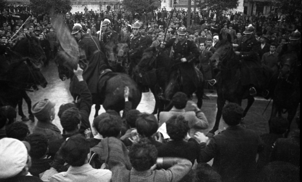 Sabre-swinging mounted police surrounded by protesters, Taksim Square 1933, © Yapı Kredi bank