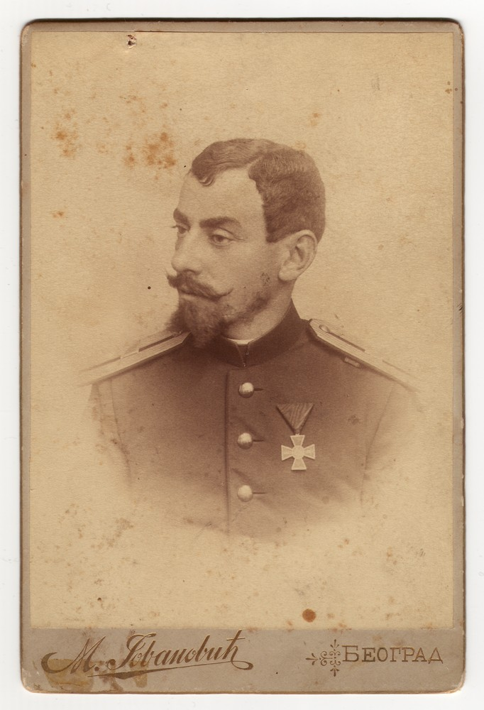 Studio portrait of a man in uniform, © Museum of Applied Art