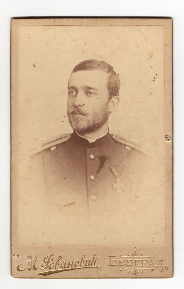 Vignetted head shot of a young man in uniform, © Museum of Applied Art