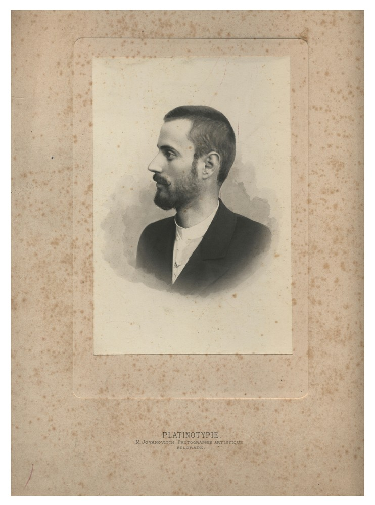 Profile view studio portrait of a man, © Miloš Jurišić