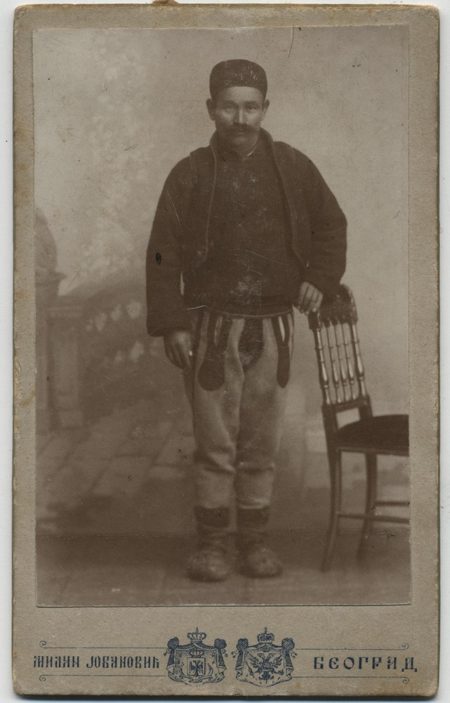 Studio portrait of a man in rural clothes, © Miloš Jurišić