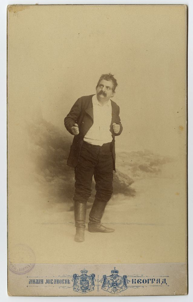 Studio portrait of Pera Dobrinović in character as 'Paja' from the play 'Pop Dobroslav', © Museum of Theater Art of Serbia