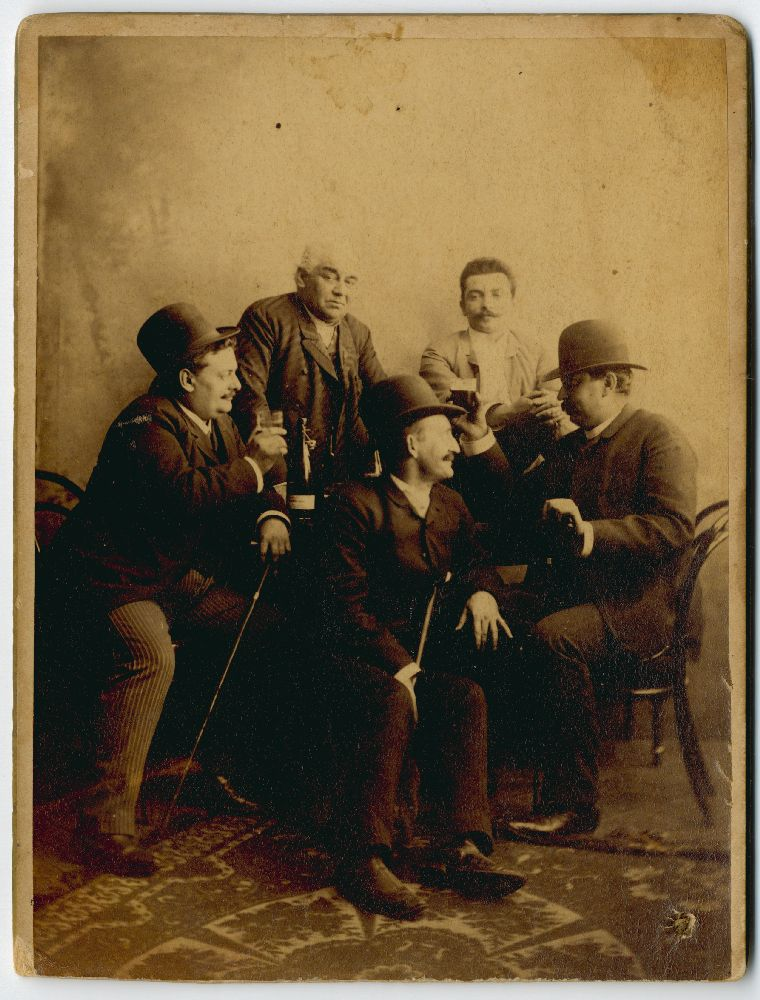 Group portrait of men around a table, © Museum of Theater Art of Serbia
