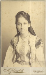 Studio portrait of a girl in traditional attire, © National Library of Serbia
