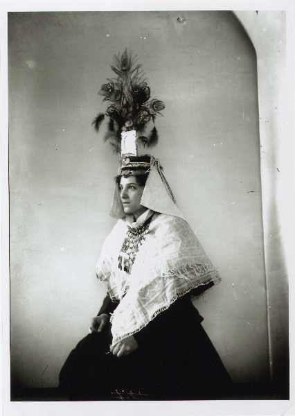 Portrait of a woman in traditional clothes and with a richly adorned headdress, © The National Museum of Bosnia and Herzegovina