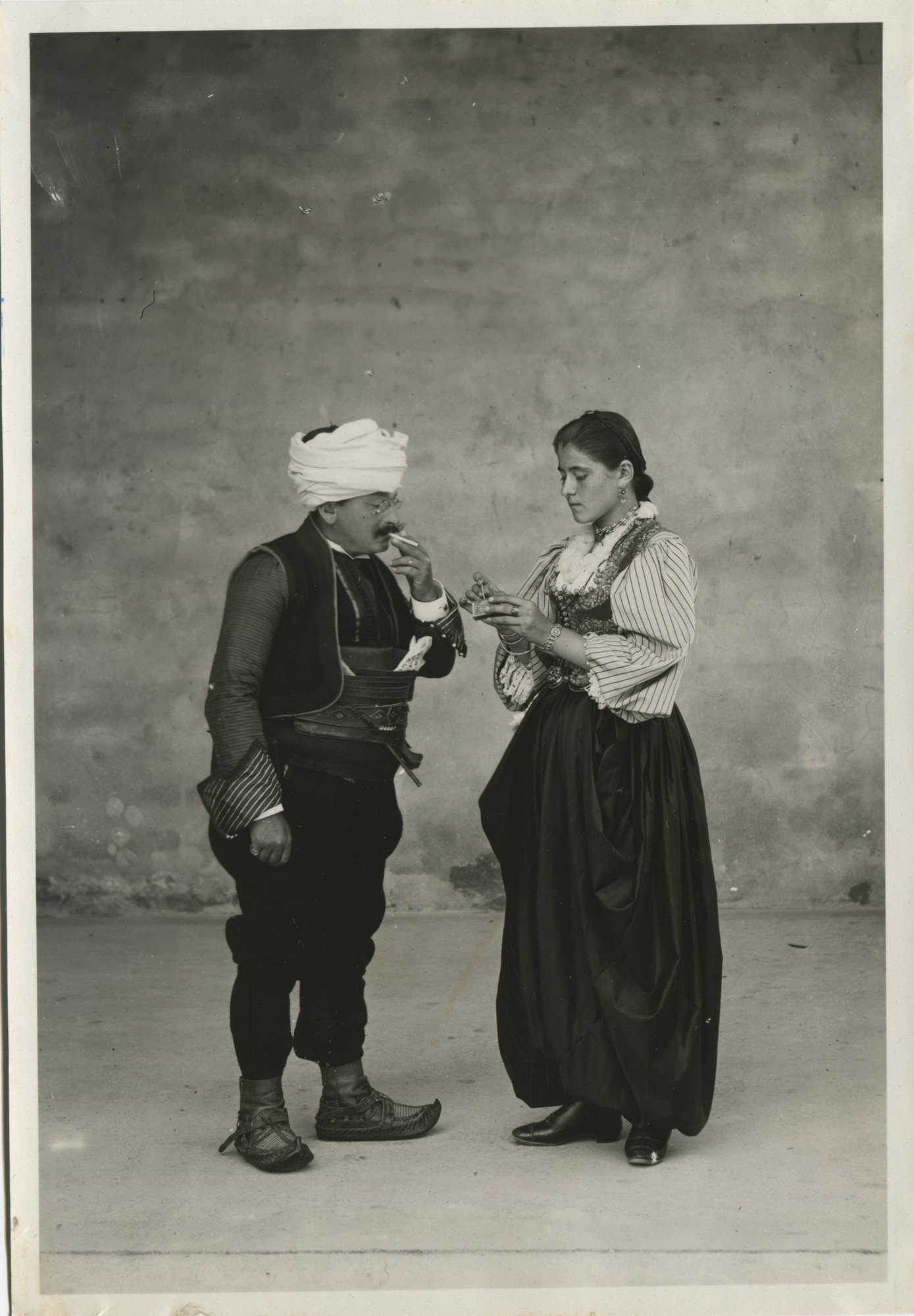 Portrait of a woman giving a man a light, © The Historical Archive of Sarajevo
