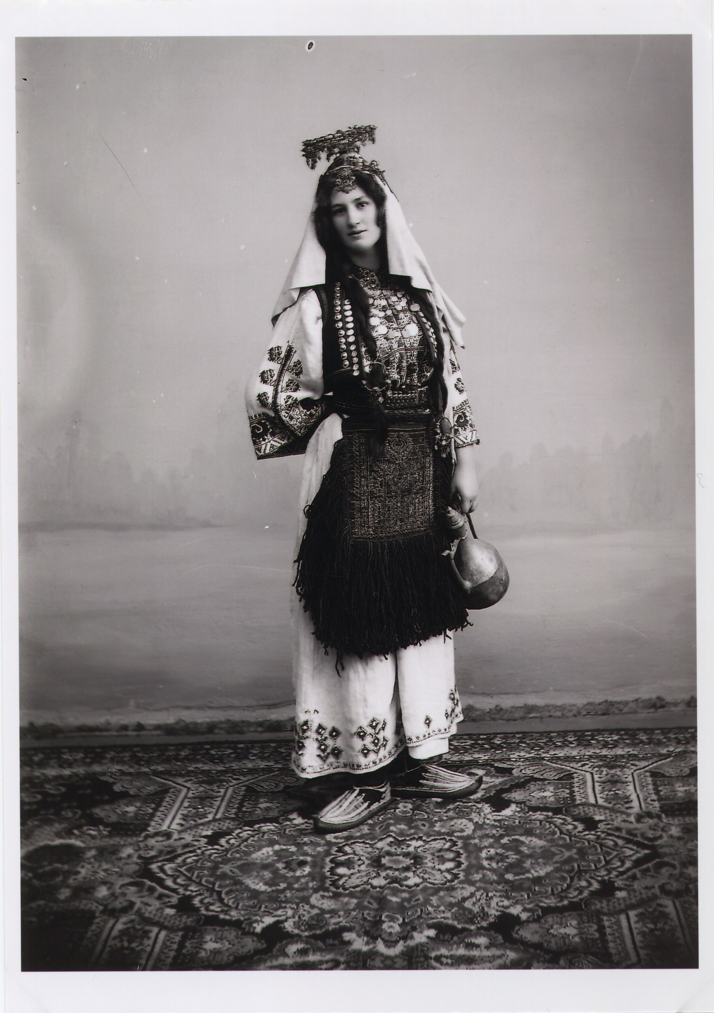 Studio portrait of a woman in traditional Orthodox clothes with a headdress, © The National Museum of Bosnia and Herzegovina