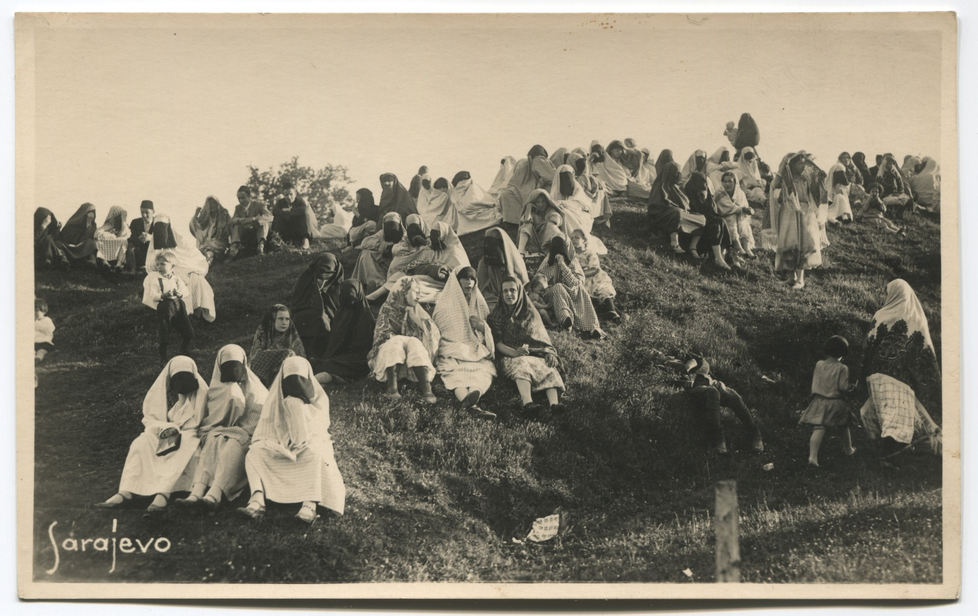 Group of people sitting on a hill, © Museum of City of Sarajevo