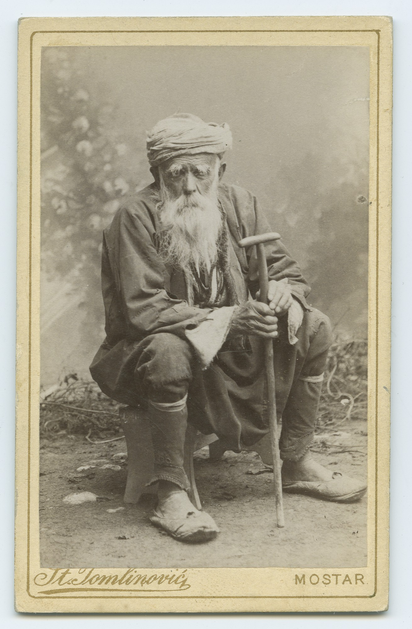 Studio portrait of a poorly dressed old man, © The Austrian Museum of Folk Life and Folk Art