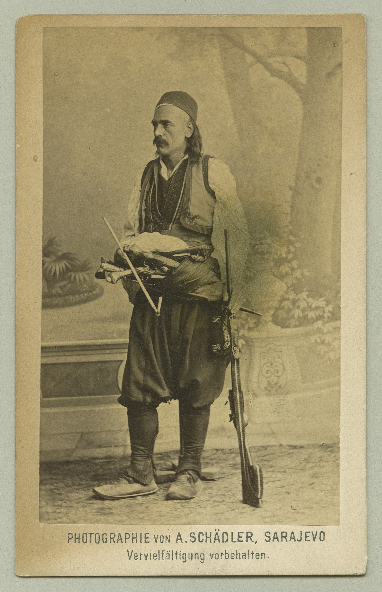 Studio portrait of a man in urban clothes with traditional elements, © The Austrian Museum of Folk Life and Folk Art