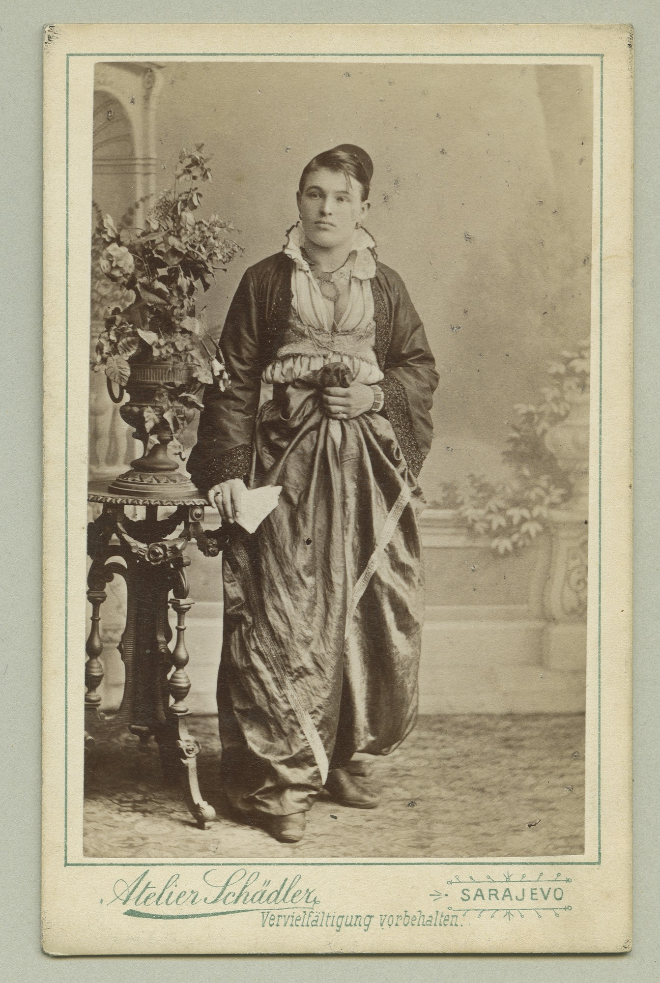 Studio portrait of a woman in an urban dress, © The Austrian Museum of Folk Life and Folk Art