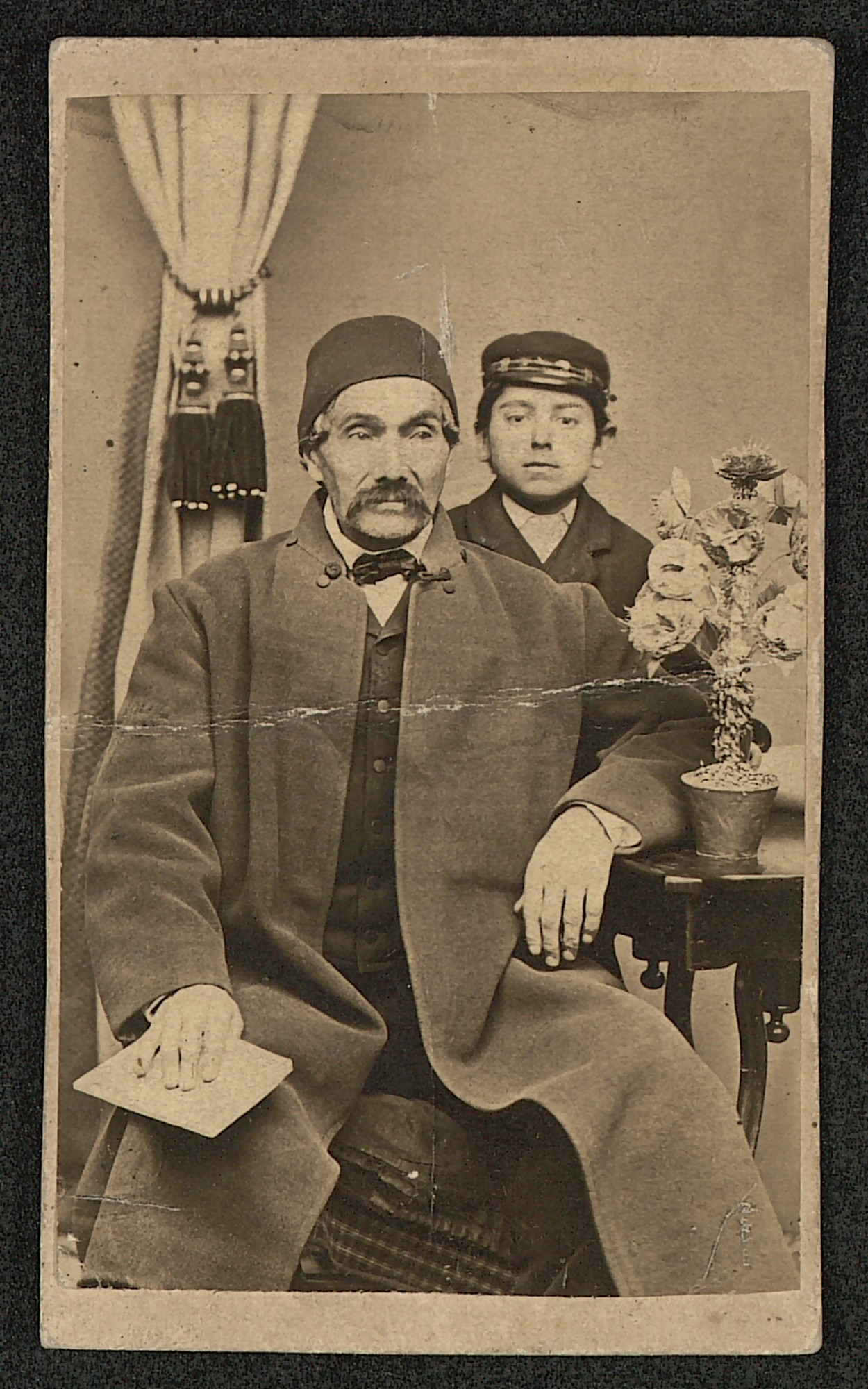 Studio portrait of Nikola Karastoyanov with his grandson Ivan, © St. Cyril and St. Methodius National Library