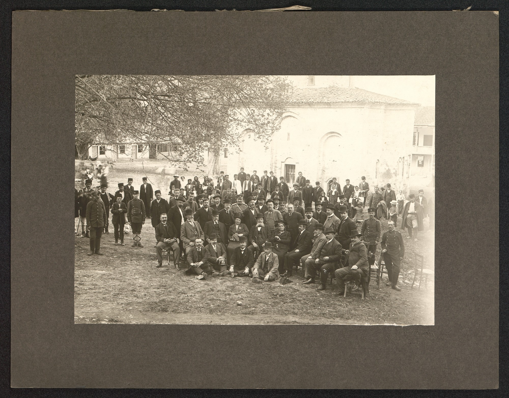 Outdoor photograph of Minister of Interior Aleksander Lyudskanov among inhabitants of the village Zemen, © St. Cyril and St. Methodius National Library