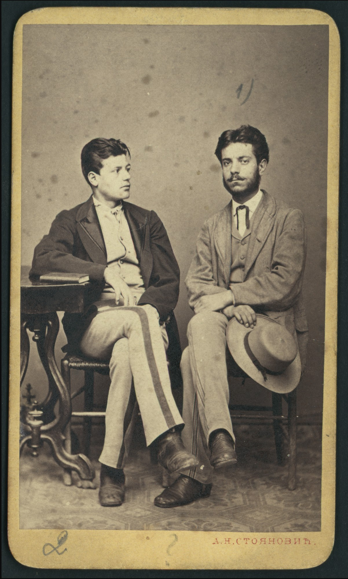 Studio portrait of two young men, © St. Cyril and St. Methodius National Library