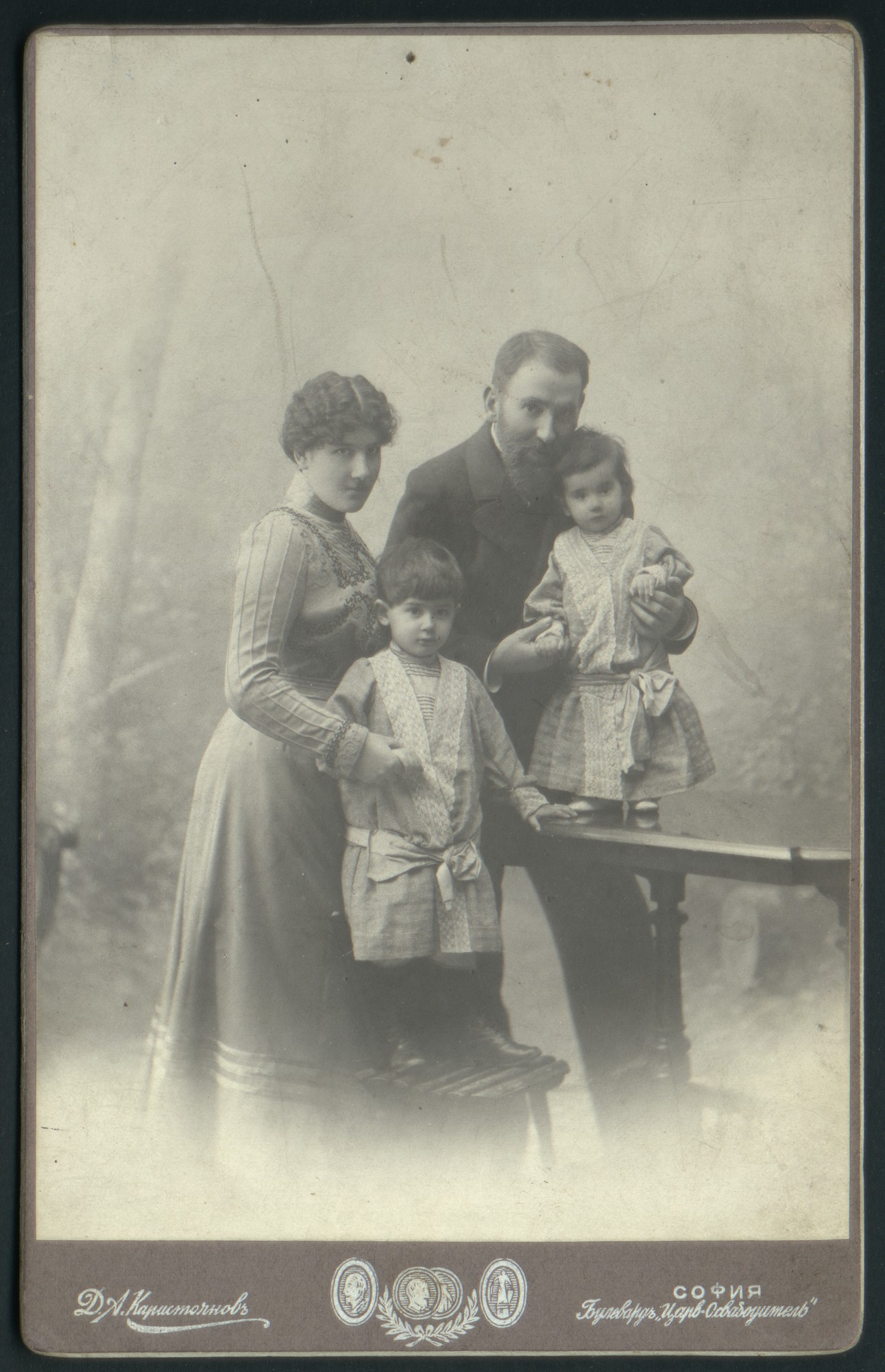 Studio portrait of Rayna and Dimitar Karastoyanov with two of their children, © St. Cyril and St. Methodius National Library
