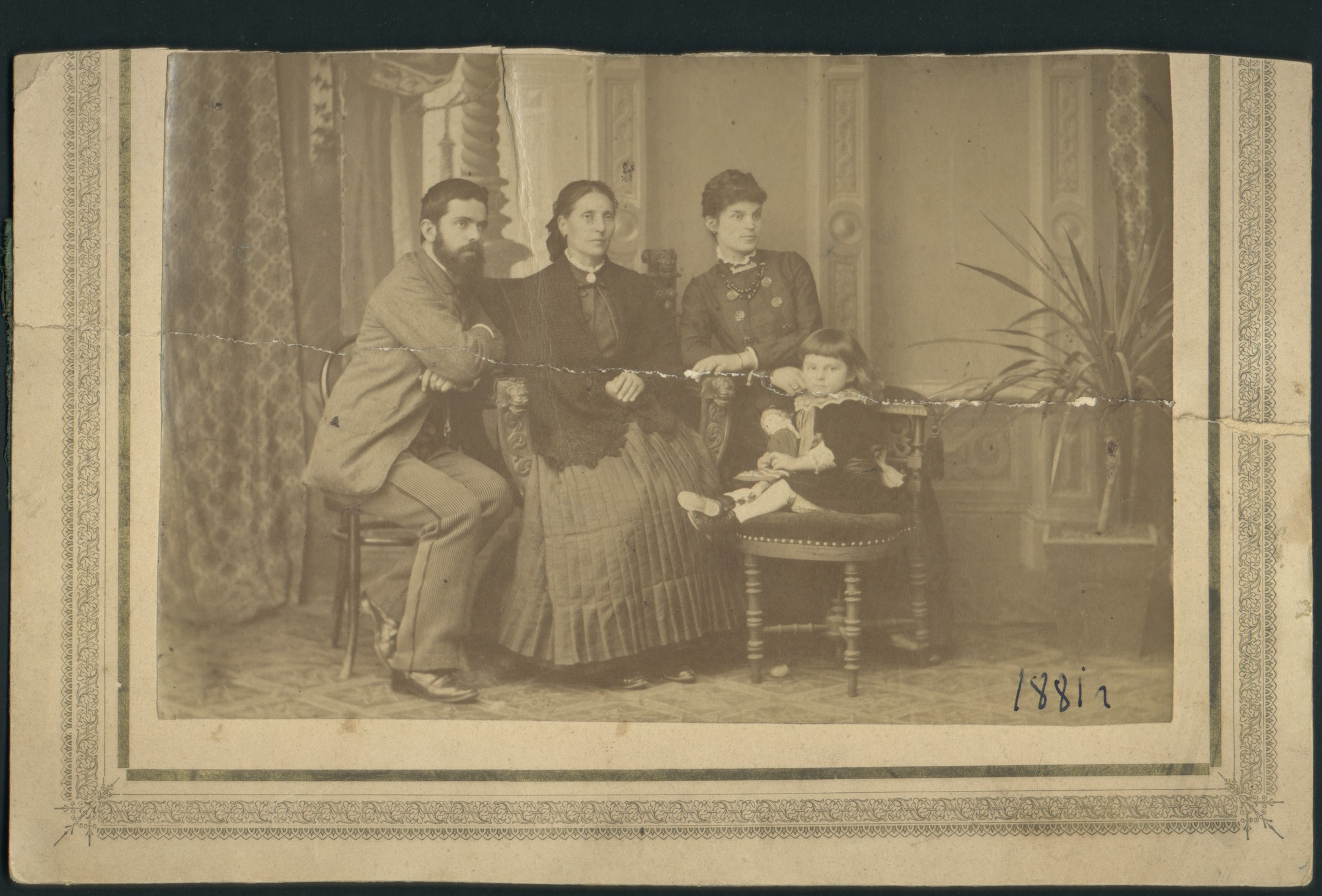 Studio portrait of Ivan Karastoyanov with his mother-in-law, wife and daughter, © St. Cyril and St. Methodius National Library