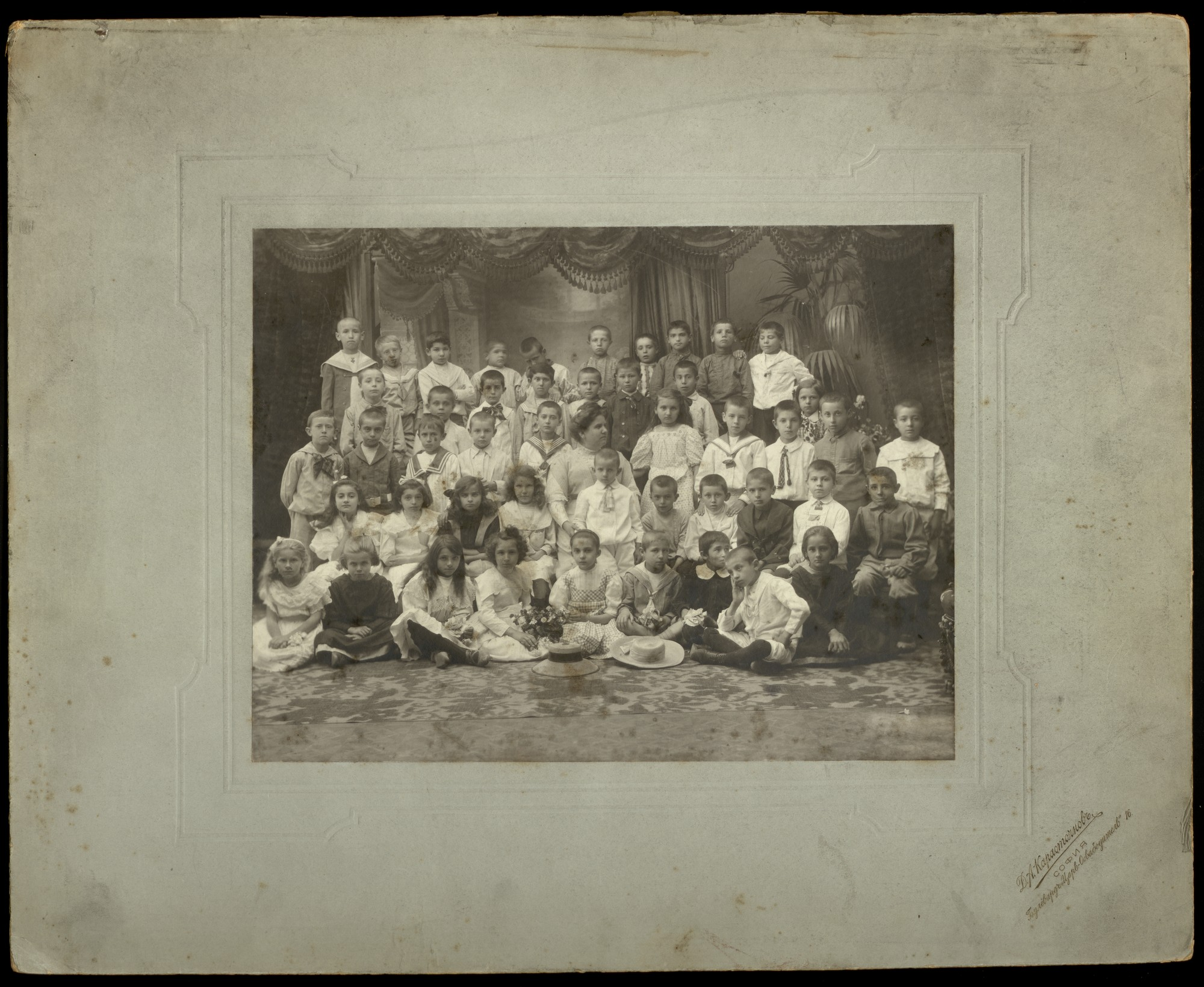 Studio portrait of Sofia Elementary school's pupils with their teacher, © St. Cyril and St. Methodius National Library