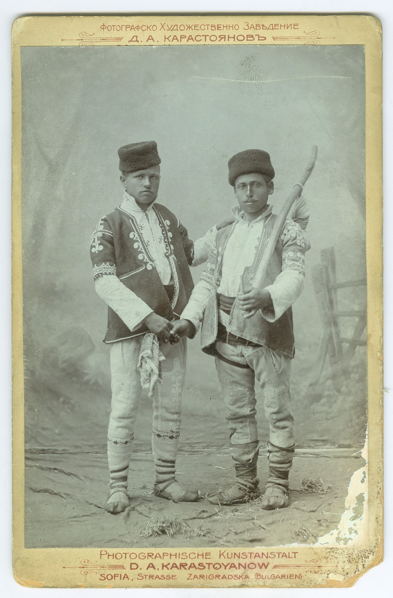 "Studio portrait of two men in folk attire, © Publishing house ""Minalo"""
