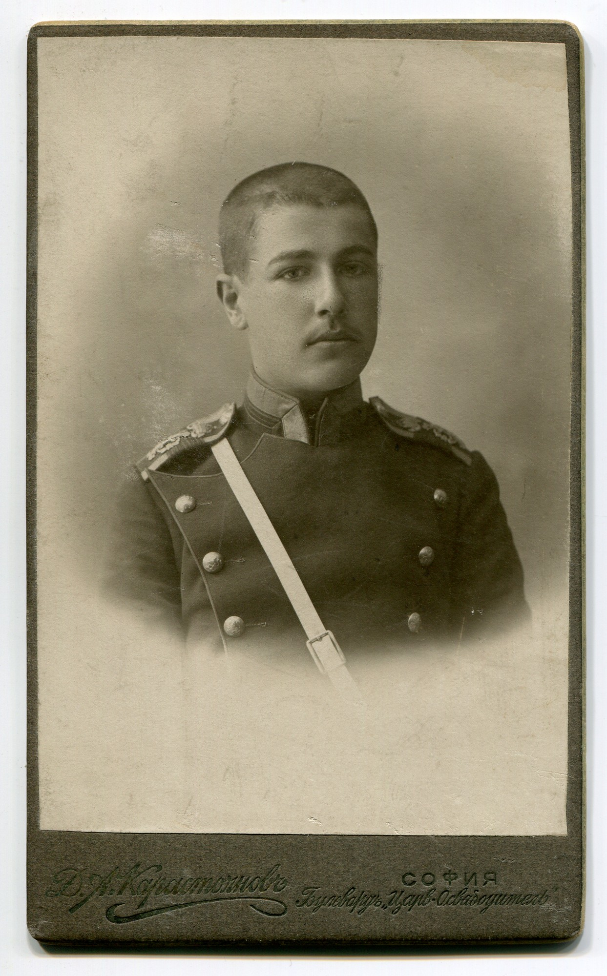 Studio portrait of a young man in a uniform, © Anelia Alexandrova Kassabova