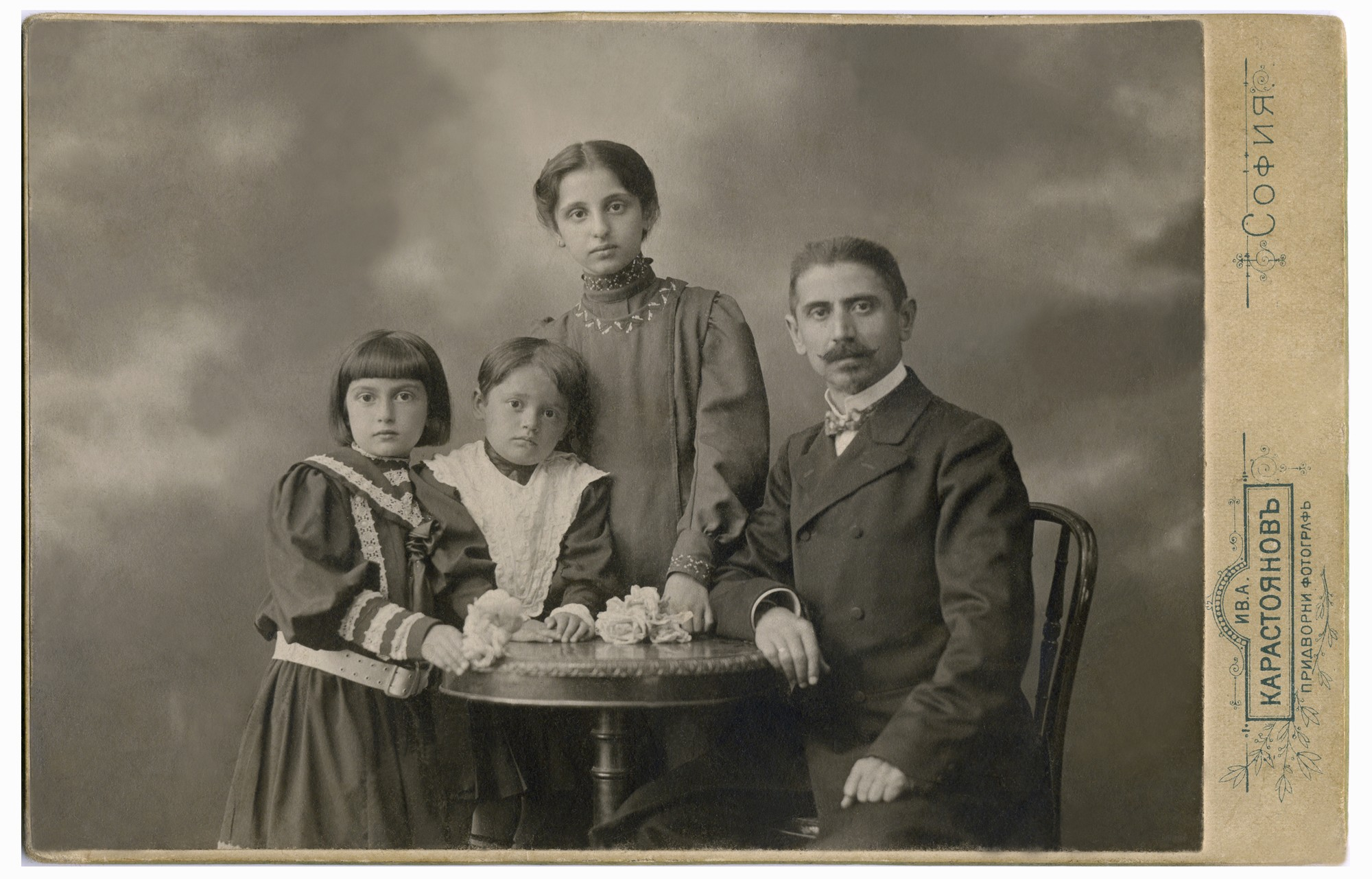 Studio portrait of Andrey Dimitrov with his three daughters, © Svetla Bogdanova