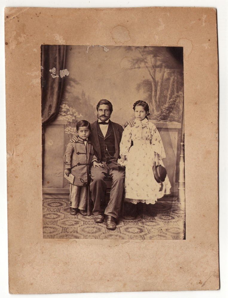 Studio portrait of a man and two children, © Museum of Applied Art