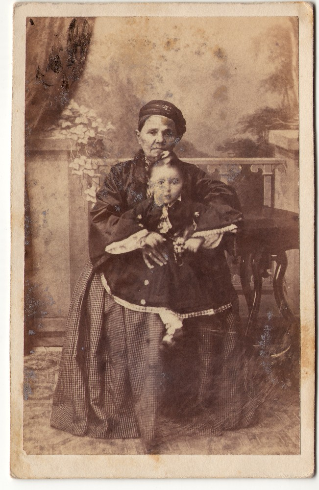 Elderly woman holding a child, © Museum of Applied Art