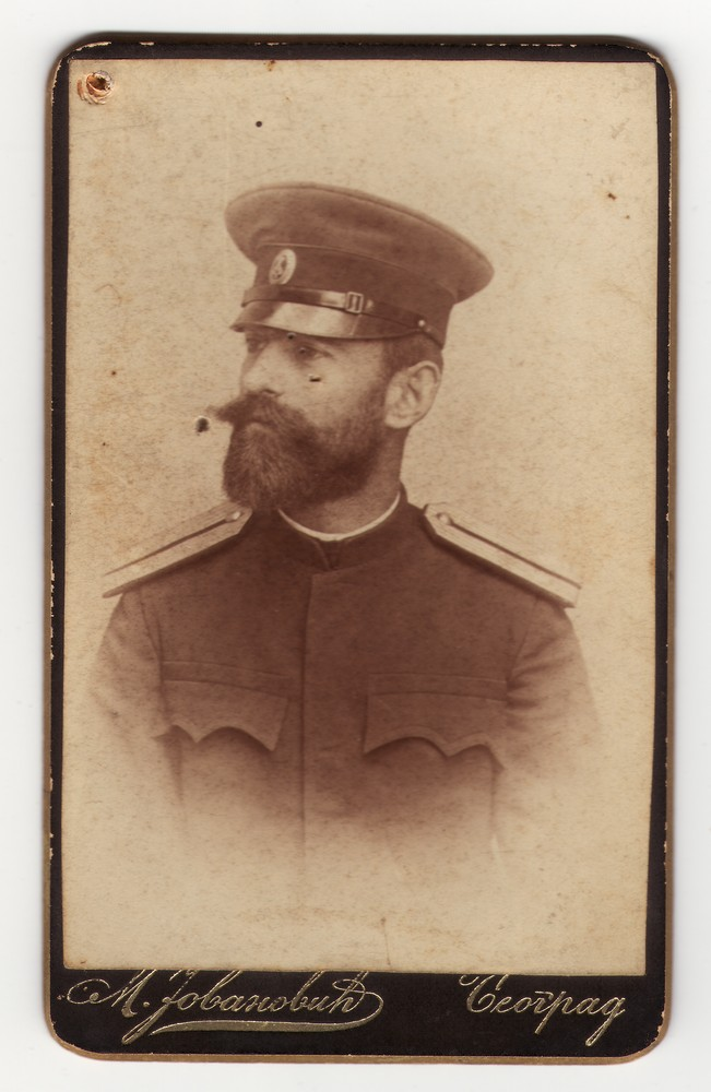 Vignetted portrait of a man in uniform with a cap, © Museum of Applied Art