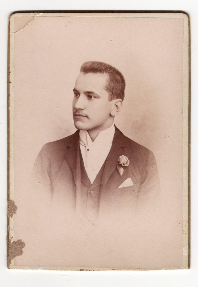 Studio portrait of a man with a rose, © Museum of Applied Art