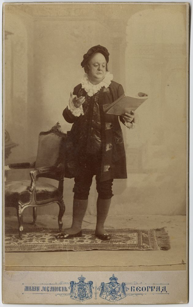Studio portrait of Pera Dobrinović in character from the play 'Nov Komad', © Museum of Theater Art of Serbia