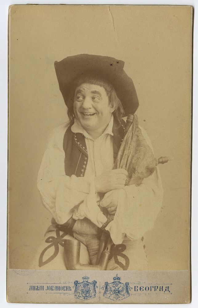 Studio portrait of Pera Dobrinović in character from the play 'Riđokosa', © Museum of Theater Art of Serbia