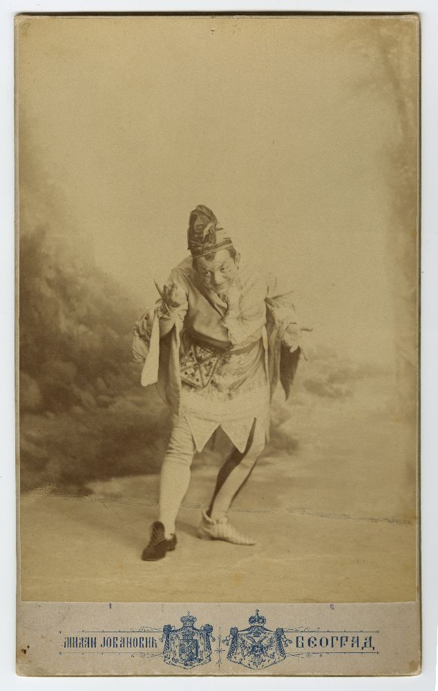 Studio portrait of Pera Dobrinović in character as 'The Fool' from the play 'King Lear', © Museum of Theater Art of Serbia
