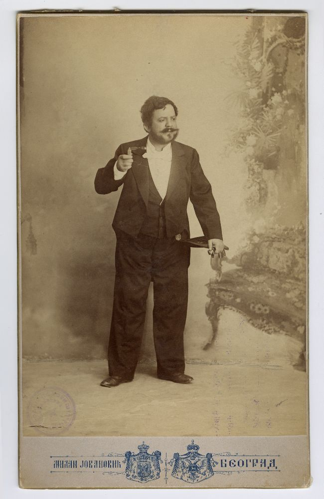 Studio portrait of Pera Dobrinović in character from the play 'Žene u ustavnom životu', © Museum of Theater Art of Serbia
