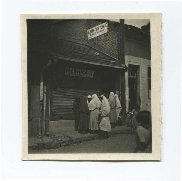 Veiled women in front of a butcher shop, © Museum of City of Sarajevo