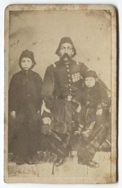 Studio portrait of a man with two children, © The Historical Archive of Sarajevo