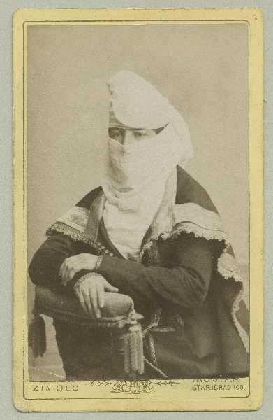 Studio portrait of a woman in Muslim clothing, © The Austrian Museum of Folk Life and Folk Art
