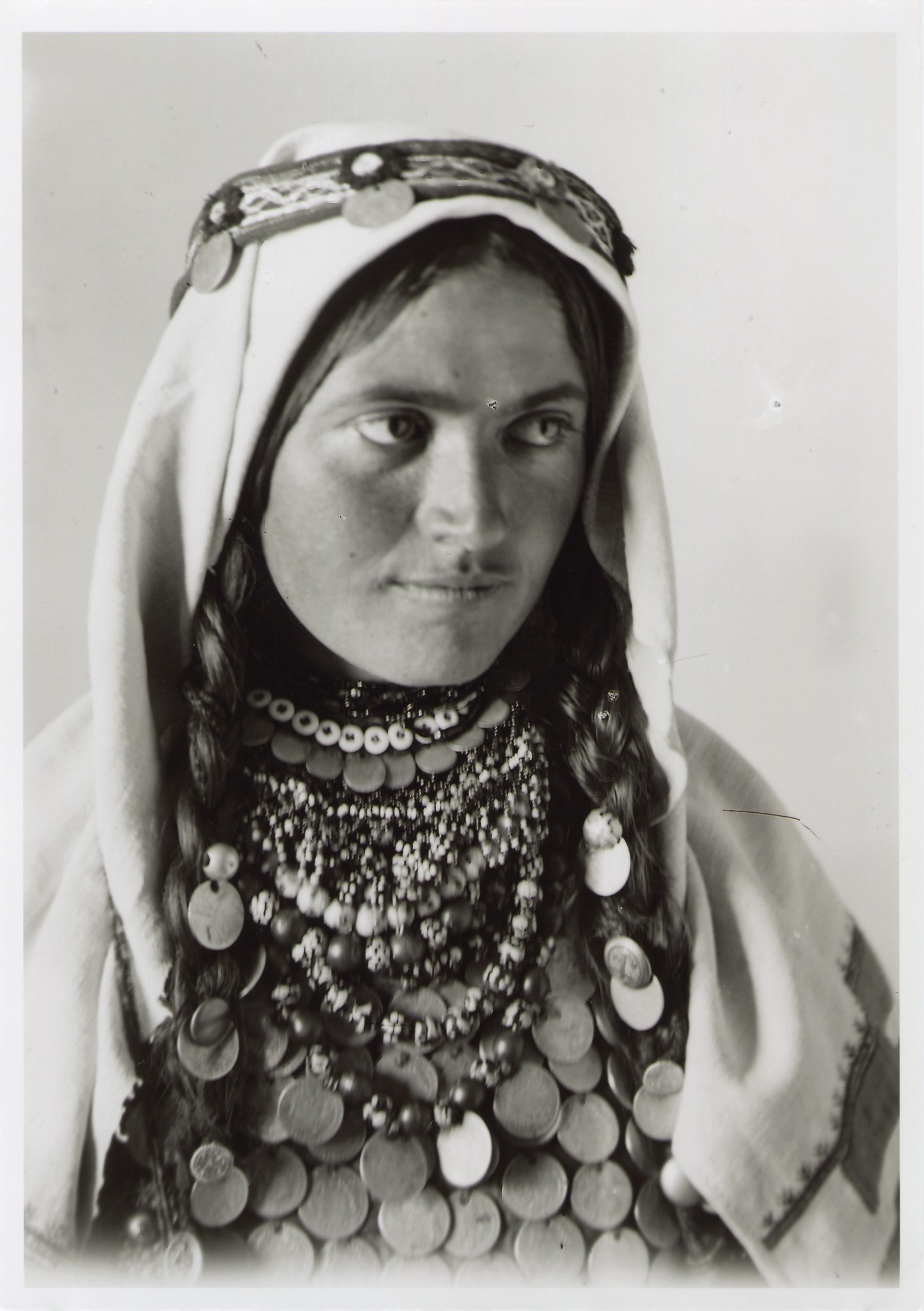Shoulder portrait of a woman with headgear and necklace, © The National Museum of Bosnia and Herzegovina