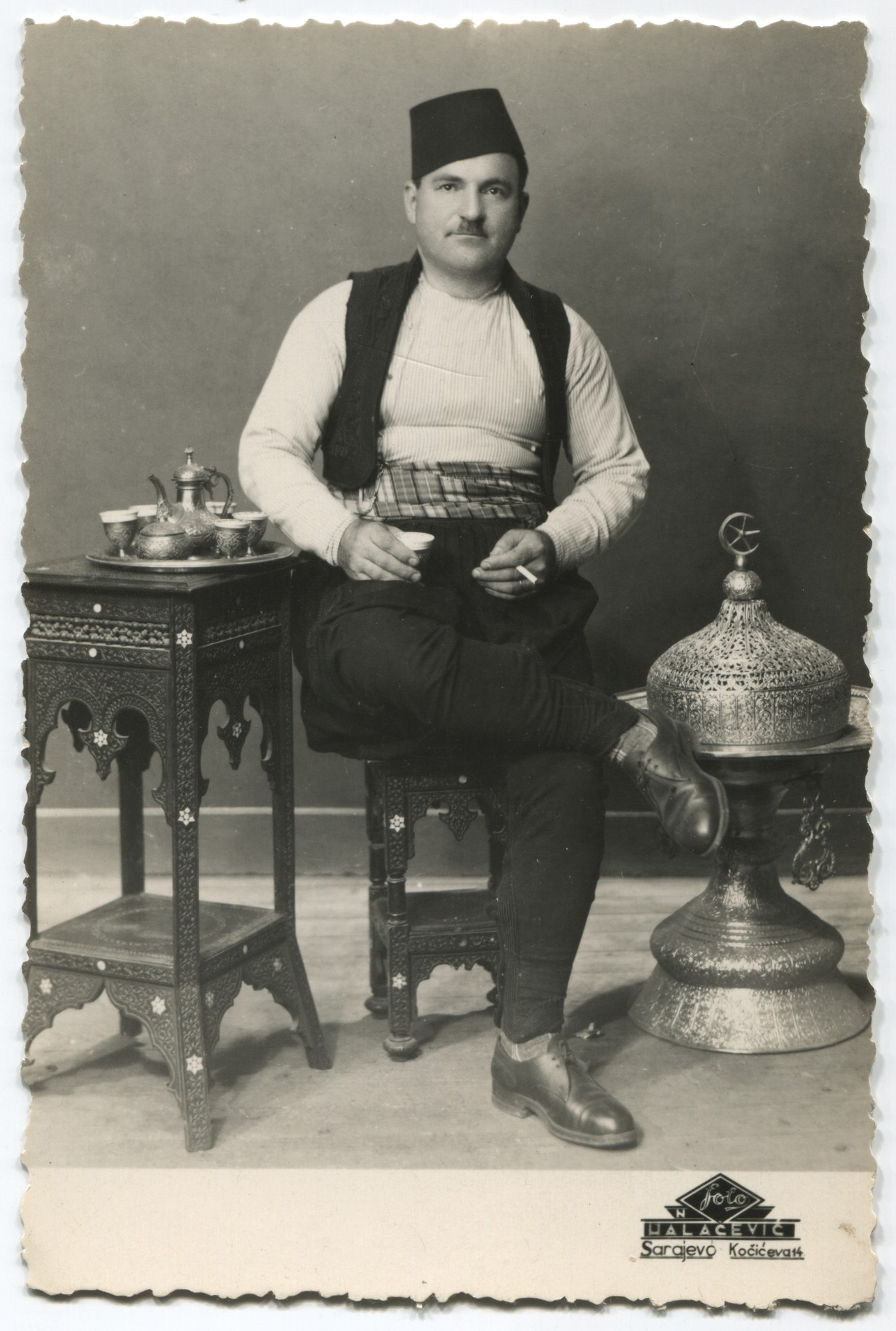 Studio portrait of a man drinking coffee, © Museum of City of Sarajevo