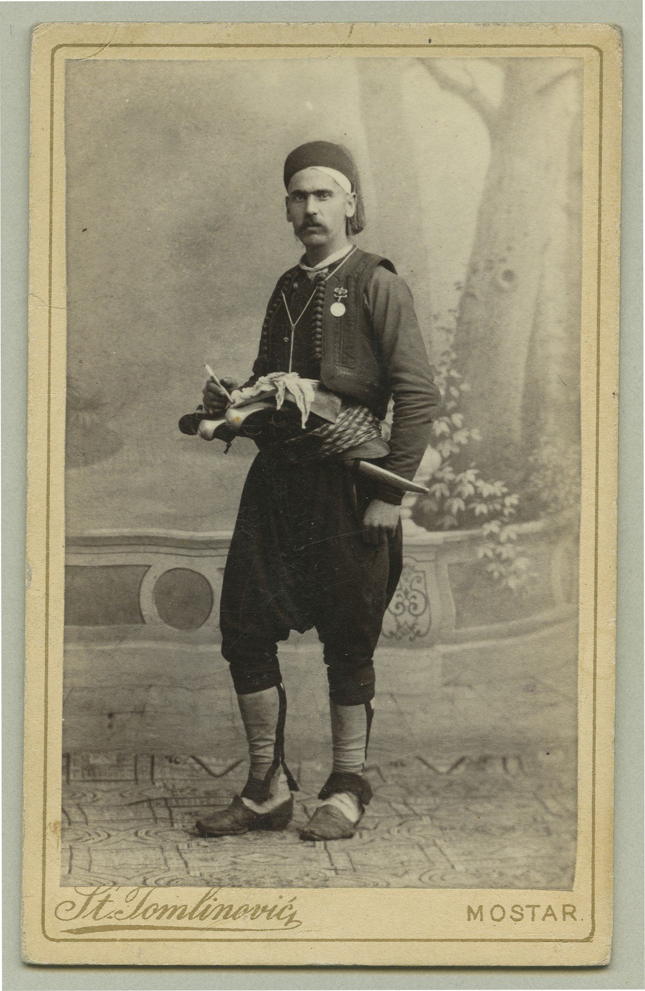 Studio portrait of a man in urban clothes from Herzegovina, © The Austrian Museum of Folk Life and Folk Art