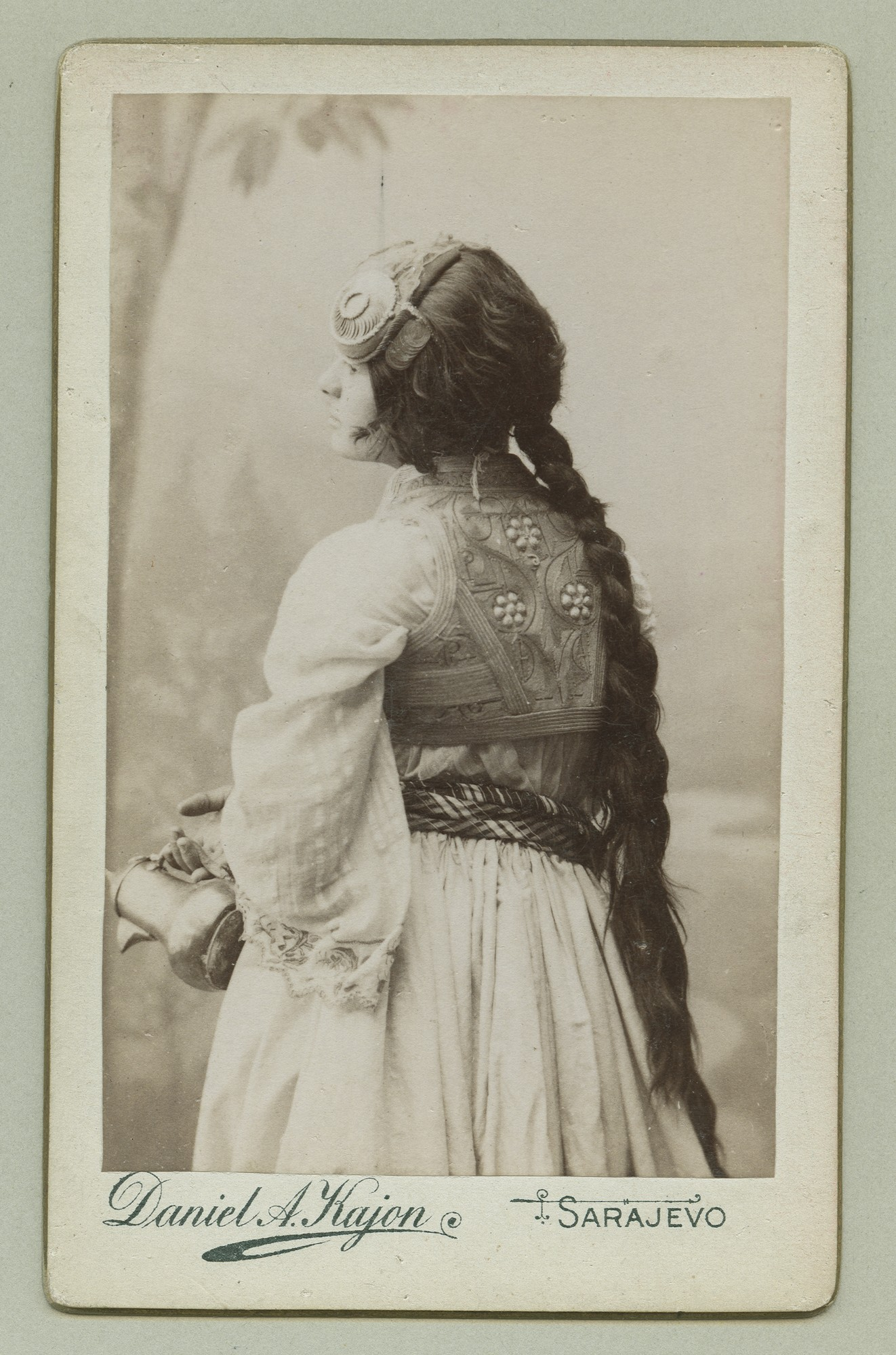 Back view studio portrait of a young woman, © The Austrian Museum of Folk Life and Folk Art