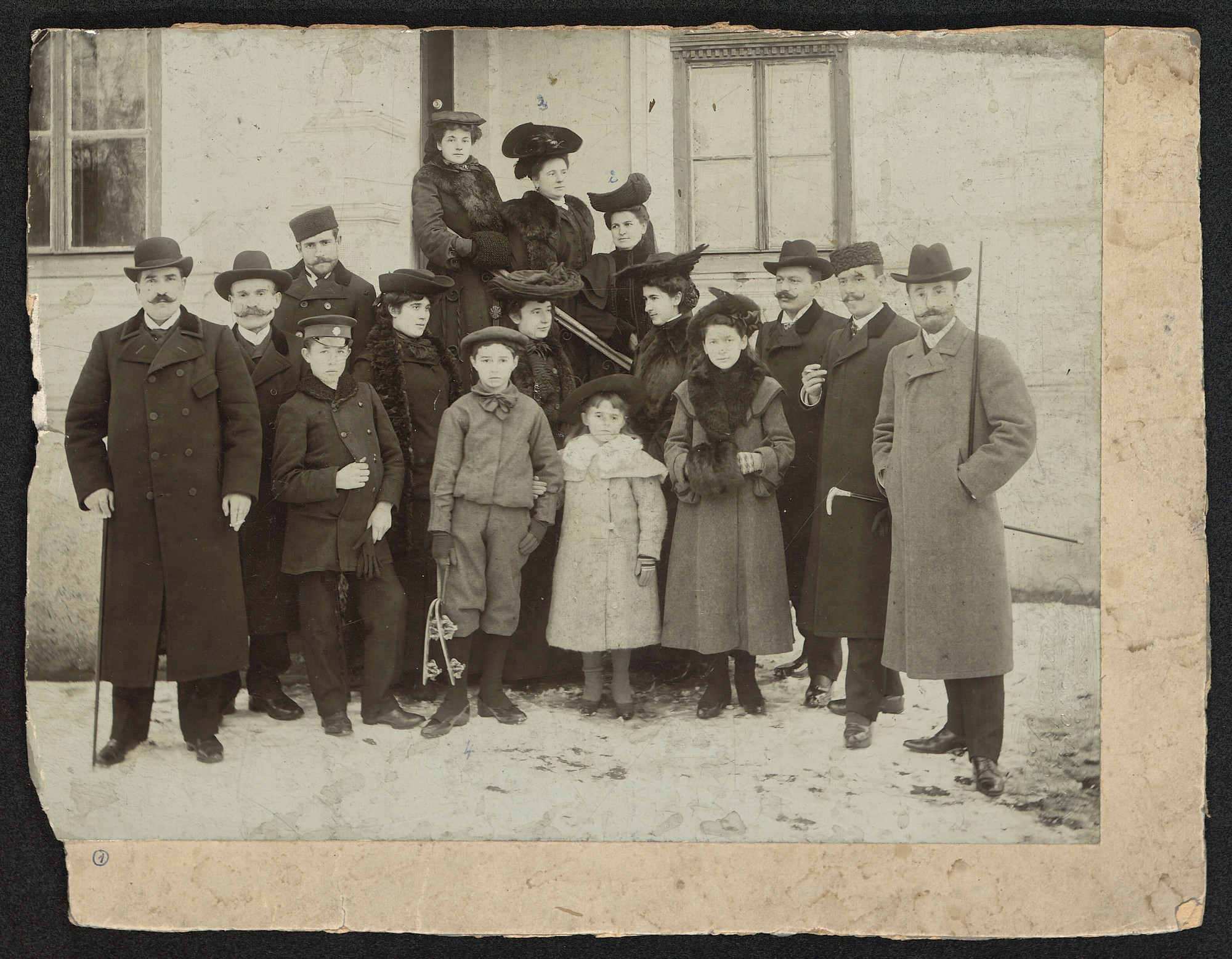 Outdoor photograph of women, men and children in urban clothes, © St. Cyril and St. Methodius National Library