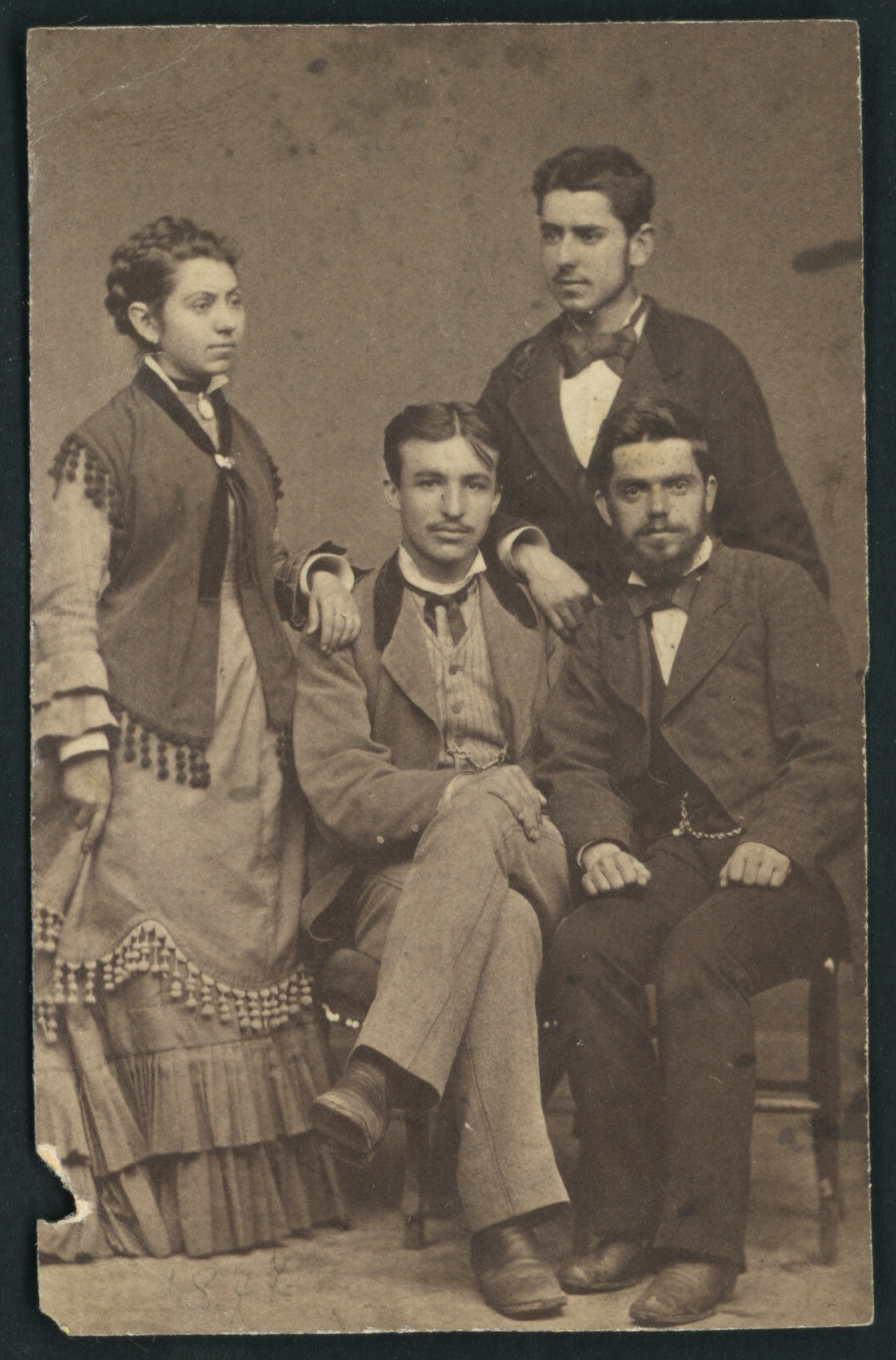 Studio group portrait of the Karastoyanov siblings with a friend, © St. Cyril and St. Methodius National Library