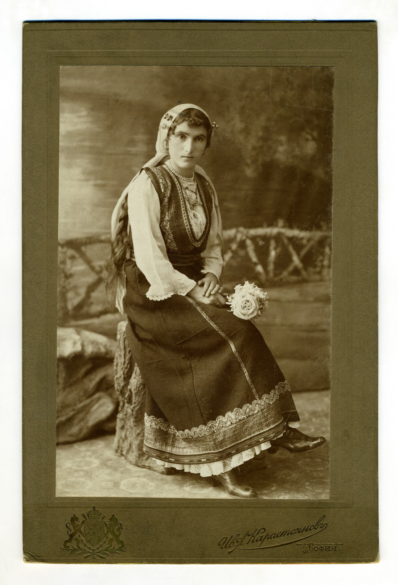 Studio portrait of a woman in folk costume, © Institute for Ethnology and Folklore Studies with Ethnographic Museum - AEIM, BAS
