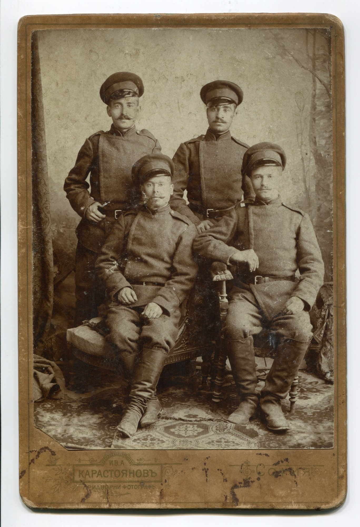 Studio group portrait of four men in uniforms, © Anelia Alexandrova Kassabova