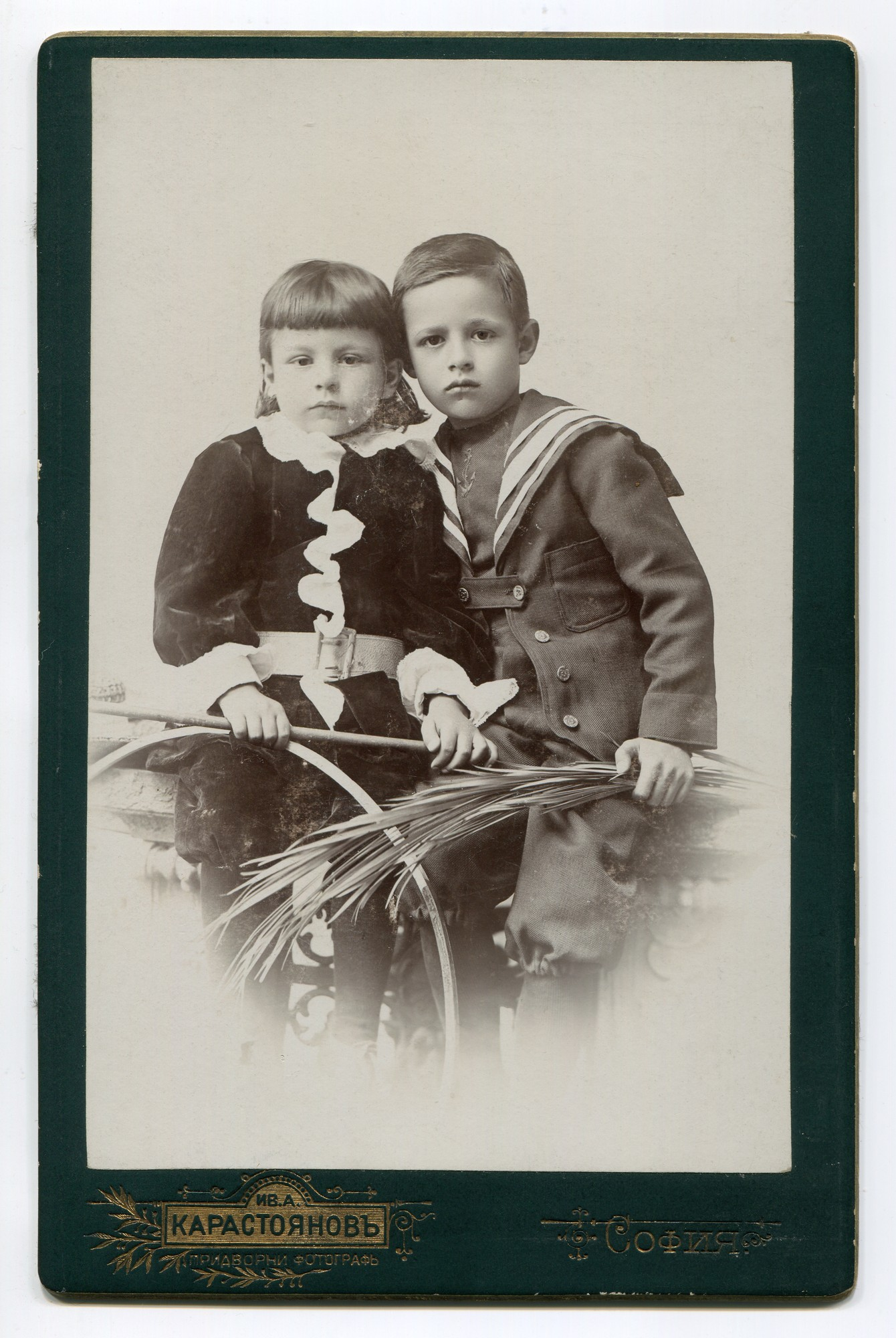 Studio portrait of two children in urban clothes, © Anelia Alexandrova Kassabova